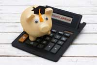 Piggy bank on calculator representing best public colleges for merit aid