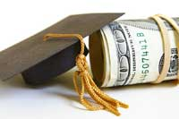 money and graduation hat representing colleges for high income families