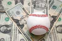 Baseball and money representing which college spend the most on d1 baseball